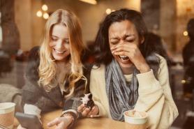 Friends enjoying a Hummingbird Bakery Cupcake